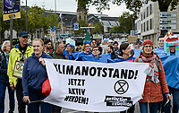 GERMANY, Hamburg city, Fridays for future, All for Climate rally with 70.000 protesters for climate protection , block of extinction rebellion movement, banner says Clomate emergency, be active now! / DEUTSCHLAND, Hamburg, Jungfernstieg und Binnenalster, Fridays-for future Bewegung, Alle fürs Klima Demo fuer Klimaschutz, Block der extinction rebellion Bewegung mit dem Symbol der ablaufenden Sanduhr, 20.9.2019