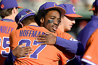 Left fielder Kier Meredith (1) of the Clemson Tigers hugs Nick Hoffman (37) before a game against the Stony Brook Seawolves on Friday, February 21, 2020, at Doug Kingsmore Stadium in Clemson, South Carolina. Clemson won, 2-0. (Tom Priddy/Four Seam Images)