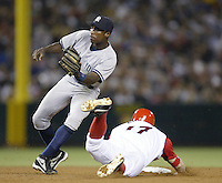 Alfonso Soriano of the New York Yankees waits for the throw as Darin Erstad of the Los Angeles Angels during slides into second base during a 2002 MLB season game against at Angel Stadium, in Anaheim, California. (Larry Goren/Four Seam Images)