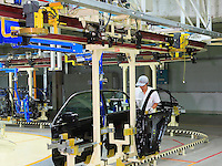 The production line of the Honda Accord at the new Guangzhou Honda Automobile Co. Ltd. factory. The plant built at a cost of 140 million US$ is one of the most advanced car plants in the world. It has a state of the art production line as well as the world's first total water re-cycling sytem..