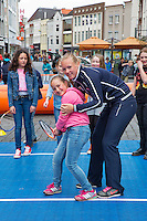 April 17, 2015, Netherlands, Den Bosch, Maaspoort, Fedcup Netherlands-Australia,  Kiki Bertens (NED) playing street tennis with schoolkids<br /> Photo: Tennisimages/Henk Koster