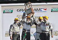 GT class winners Andy Lally, John Potter, Ricahrd Liets and Rene Rast celebrate after the Rolex 24 at Daytona, Daytona International Speedway, Daytona Beach, FL, January 2011.  (Photo by Brian Cleary/www.bcpix.com)