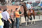 Courageous Cat & Jose Lezcano win the 26th running of the Grade 3 Poker Stakes for 3 year olds & up, at 1 mile on the turf, at Belmont Park. Trainer Bill Mott.  Owner Martin and Pam Wygod.