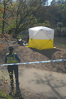 Pictured: South Wales police officers and a forensics team are investigating a body found in river Taff in the Coryton area of Cardiff, Wales, UK.