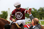 NEW ORLEANS, LA - MARCH 26: Florent Geroux celebrates winning the 103rd Louisiana Derby riding Gun Runner #1 at Fairgrounds Race Course on March 26, 2016 in New Orleans, Louisiana. (Photo by Steve Dalmado/Eclipse Sportswire/Getty Images)