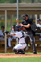 Umpire Chase Eubanks calls a strike behind FCL Tigers West catcher Mike Rothenberg (37) during a game against the FCL Yankees on July 31, 2021 at Tigertown in Lakeland, Florida.  (Mike Janes/Four Seam Images)