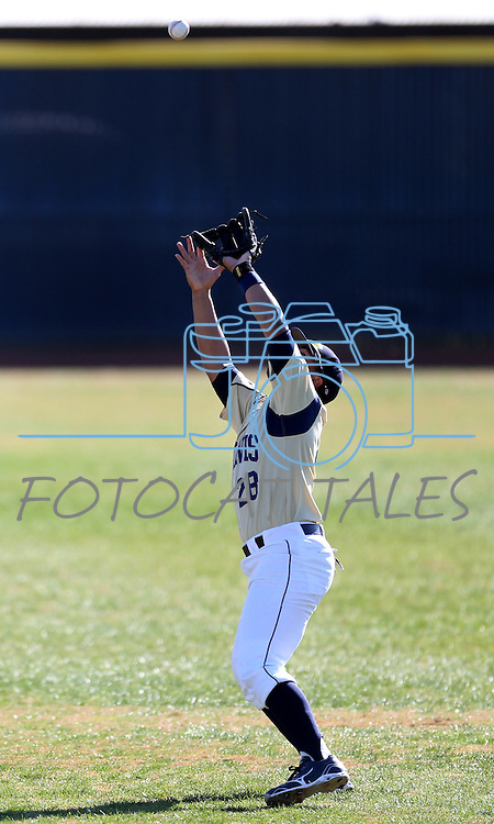 UC Davis' Steven Patterson makes a catch in a college baseball game between the Washington Huskies and the UC Davis Aggies in Davis, Ca., on Sunday, Feb. 17, 2013. Davis won 7-5 to finish their season opening series 3-1. .Photo by Cathleen Allison