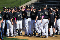 Wake Forest Demon Deacons head coach Tom Walter (16) brings his team together prior to the start of the game against the Florida State Seminoles at David F. Couch Ballpark on April 16, 2016 in Winston-Salem, North Carolina.  The Seminoles defeated the Demon Deacons 13-8.  (Brian Westerholt/Four Seam Images)