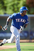 Texas Rangers Yanio Perez (16) during an Instructional League game against the Kansas City Royals on October 4, 2016 at the Surprise Stadium Complex in Surprise, Arizona.  (Mike Janes/Four Seam Images)