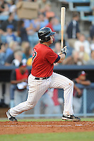 Michael Zuanich First Baseman Asheville Tourists (Colorado Rockies) swings at a pitch at McCormick Field August 13, 2009 in Asheville, NC (Photo by Tony Farlow/Four Seam Images)