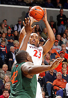 CHARLOTTESVILLE, VA- JANUARY 7: Mike Scott #23 of the Virginia Cavaliers shoots over Reggie Johnson #42 of the Miami Hurricanes during the game on January 7, 2012 at the John Paul Jones Arena in Charlottesville, Virginia. Virginia defeated Miami 52-51. (Photo by Andrew Shurtleff/Getty Images) *** Local Caption *** Mike Scott;Reggie Johnson