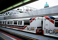 Vancouver: Expo '86: Skytrain at Stadium Station, Sun Tower in background.