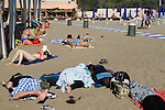 Venice Italy 2009. Venice Lido public beach young people, the morning after the night before.