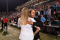 Portland Thorns head coach Cindy Parlow Cone and Western New York Flash head coach Aaran Lines greet each other before the start of the match. The Portland Thorns defeated the Western New York Flash 2-0 during the National Women's Soccer League (NWSL) finals at Sahlen's Stadium in Rochester, NY, on August 31, 2013.