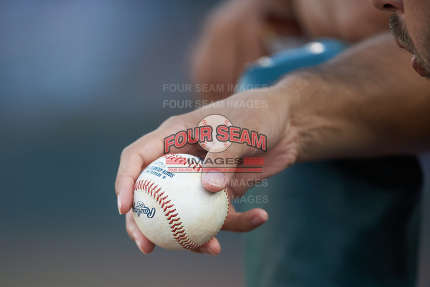 Hickory Crawdads trainer Bronson Santillan holds a South Atlantic League baseball during the game against the Charleston RiverDogs at L.P. Frans Stadium on August 10, 2019 in Hickory, North Carolina. The RiverDogs defeated the Crawdads 10-9. (Brian Westerholt/Four Seam Images)