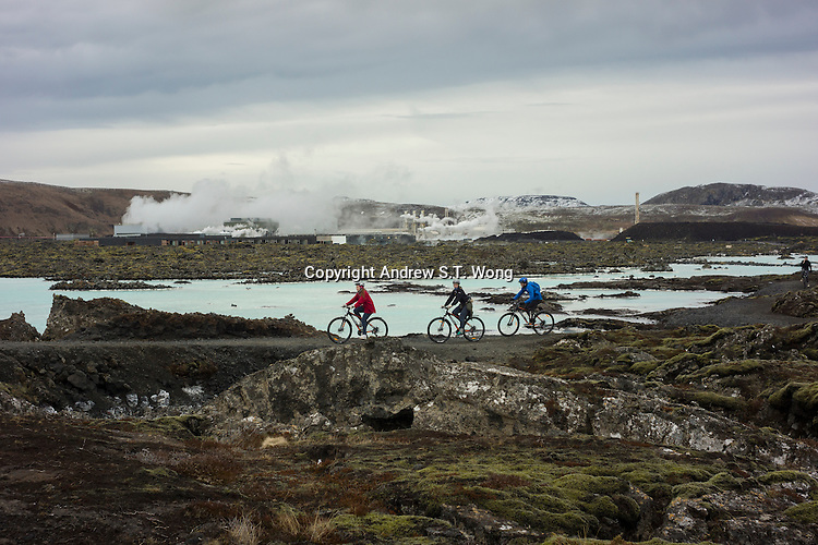 The Blue Lagoon, Iceland - Tourists ride their bikes around the Blue Lagoon, Iceland, March 2016. The Blue Lagoon geothermal spa is one of the most visited attractions in Iceland. The spa is located in a lava field in Grindavík on the Reykjanes Peninsula, southwestern Iceland.