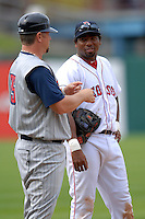 Infielder Hector Luna #20 of the Pawtucket Red Sox has a conversation with Toledo manager Phil Nevin during a game versus the Toledo Mud Hens on May 3, 2011 at McCoy Stadium in Pawtucket, Rhode Island. Photo by Ken Babbitt /Four Seam Images