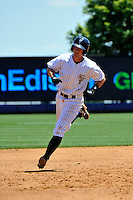 Staten Island Yankees first baseman Casey Stevenson #28 hits a homerun during a game against the State College Spikes at Richmond County Bank Ballpark at St. George on July 14, 2011 in Staten Island, NY.  Staten Island defeated State College 6-4.  Tomasso DeRosa/Four Seam Images