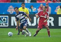 24 July 2010: FC Dallas midfielder Bruno Guarda #8 and Toronto FC midfielder Nick LaBrocca #21 in action during a game between FC Dallas and Toronto FC at BMO Field in Toronto..The final score was a 1-1 draw...