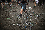 © Joel Goodman - 07973 332324 . . 12/06/2016 . Manchester , UK . Mud and discarded drinks bottles on the ground at the Parklife music festival at Heaton Park in Manchester . Photo credit : Joel Goodman