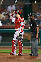 Scottsdale Scorpions Taylor Ward (9), of the Los Angeles Angels of Anaheim organization, and umpire Ramon De Jesus during a game against the Mesa Solar Sox on October 17, 2016 at Scottsdale Stadium in Scottsdale, Arizona.  Mesa defeated Scottsdale 12-2.  (Mike Janes/Four Seam Images)