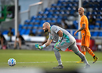 LAKE BUENA VISTA, FL - JULY 18: Marko Maric #1 of the Houston Dynamo rolls the ball to a teammate during a game between Houston Dynamo and Portland Timbers at ESPN Wide World of Sports on July 18, 2020 in Lake Buena Vista, Florida.