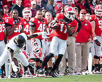 The Georgia Bulldogs beat the App State Mountaineers 45-6 in their homecoming game.  After a close first half, UGA scored 31 unanswered points in the second half.  Georgia Bulldogs wide receiver Rantavious Wooten (17), Appalachian State Mountaineers defensive back Rodger Walker (4)