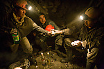 Miners sharing drinks at the end of a shift.