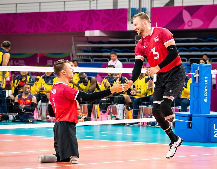 Austin Hinchey and Jesse Ward, Lima 2019 - Sitting Volleyball // Volleyball assis.<br /> Canada competes for the bronze medal in men's Sitting Volleyball // Canada participe pour la médaille de bronze en volleyball assis masculin. 28/08/2019.