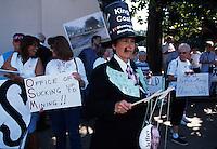 Rally against King Coal brings all ages together in a protest in downtown Charleston.