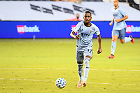 KANSAS CITY, UNITED STATES - AUGUST 25: Gadi Kinda #17 of Sporting Kansas City takes the ball up field  a game between Houston Dynamo and Sporting Kansas City at Children's Mercy Park on August 25, 2020 in Kansas City, Kansas.