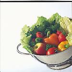 rinsing fruit and vegetables in colander