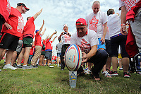 Pictured: Russian participants set a ball before the attempt in Cardiff, Wales, UK. Wednesday 24 August 2016<br />Re: The largest rugby scrum has been achieved by Golden Oldies at University Fields in Cardiff south Wales, UK. It was refereed by welsh international referee Nigel Owens. Guinness World Records has verified the new record in which 1297 people took part in.