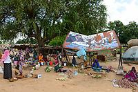 CHAD, Goz Beida, market, rotten image of president Idriss Déby Itno / TSCHAD, Goz Beida, Markt, durch haengendes schaebiges Bild von Prasesident Idriss Déby Itno