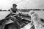 Bob Cross, the ferryman, Southwold ferry across the river Blyth to Walberswick Suffolk. UK. 1984.