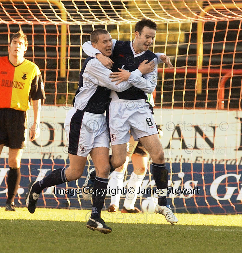 29/01/2005  Copyright Pic : James Stewart.File Name : jspa03_partick v raith.CONALL MUTAGH IS CONGRATULATED AFTER HE SCORES RAITH'S FIRST........Payments to :.James Stewart Photo Agency 19 Carronlea Drive, Falkirk. FK2 8DN      Vat Reg No. 607 6932 25.Office     : +44 (0)1324 570906     .Mobile   : +44 (0)7721 416997.Fax         : +44 (0)1324 570906.E-mail  :  jim@jspa.co.uk.If you require further information then contact Jim Stewart on any of the numbers above.........A
