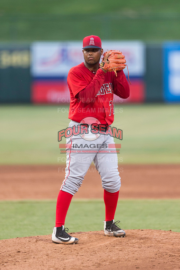 AZL Angels relief pitcher Yoel De Leon (71) gets ready to deliver a pitch during an Arizona League game against the AZL Diamondbacks at Tempe Diablo Stadium on July 16, 2018 in Tempe, Arizona. The AZL Diamondbacks defeated the AZL Angels by a score of 4-3. (Zachary Lucy/Four Seam Images)