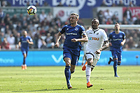 (L-R) Phil Jagielka of Everton and Jordan Ayew of Swansea City chase the ball during the Premier League match between Swansea City and Everton at The Liberty Stadium, Swansea, Wales, UK. Saturday 14 April 2018