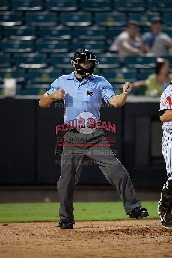 Umpire Ben Sonntag strikeout call during a Southern League game between the Mississippi Braves and Jackson Generals on July 23, 2019 at The Ballpark at Jackson in Jackson, Tennessee.  Mississippi defeated Jackson 1-0 in the second game of a doubleheader.  (Mike Janes/Four Seam Images)