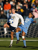 Notre Dame Fighting Irish defender Carrie Dew (19) and North Carolina Tar Heels forward Jessica McDonald (47). The North Carolina Tar Heels defeated the Notre Dame Fighting Irish 2-1 during the finals of the NCAA Women's College Cup at Wakemed Soccer Park in Cary, NC, on December 7, 2008. Photo by Howard C. Smith/isiphotos.com