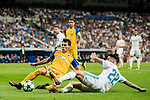 Isco Alarcon (r) of Real Madrid competes for the ball with Praxitellis Vouros of APOEL FC during the UEFA Champions League 2017-18 match between Real Madrid and APOEL FC at Estadio Santiago Bernabeu on 13 September 2017 in Madrid, Spain. Photo by Diego Gonzalez / Power Sport Images
