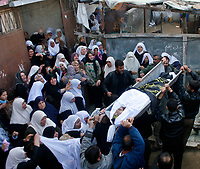 "Palestinians carry the body of Islamic Jihad militant Jodah Nabhan, who was killed with his brother Saed, in an Israeli air strike on Thursday, during their funeral in the northern Gaza Strip February 7, 2008. Israeli troops backed by tanks and warplanes launched a raid into the northern Gaza Strip on Thursday, killing five Hamas gunmen and a schoolteacher, the ruling Palestinian Islamist faction and hospital officials .""photo by Fady Adwan"""