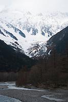 The Azusa River flows across the Kamikochi plains at the base of the Hotaka Range.