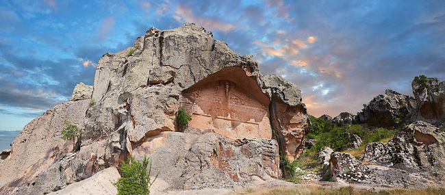 "The Unfinished rock monument of Midas, 8th - 6th century BC . Midas City, Yazilikaya, Eskisehir, Turkey.<br /> <br /> This rock facade was planned but never finished and so little is known about the unfinished Monument. It is also known locally as the Kucuk Yazilikaya ( ""little written rock""), since it appears to have been planned as a smaller version of the Midas Monument, also called Yazilikaya. It measures 7m x 10m and faces west, unlike the other monument at Midas whose facades face east. Since it was never completed, it was gives some idea of the construction techniques : first the rock was flattened and then the facade was carved from the top down. The architectural frame and the ornament were carved at the same time. About  2m below the monument are a smaller facade, to the left and a small cut altar to the right."