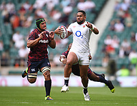 4th July 2021; Twickenham, London, England; International Rugby, Autumn Internationals, England versus United States of America; Joe Cokanasiga of England shrugs off the tackles from Mikey Te'o and Jamason Fa'anana-Schultz of USA to go on and score a try