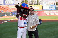 Field of Dreams actor Dwier Brown, who played John Kinsella in the movie, with mascot Buster T. Bison after the ceremonial first pitch before a Buffalo Bisons International League game against the Syracuse Mets on June 29, 2019 at Sahlen Field in Buffalo, New York.  Buffalo defeated Syracuse 9-3.  (Mike Janes/Four Seam Images)