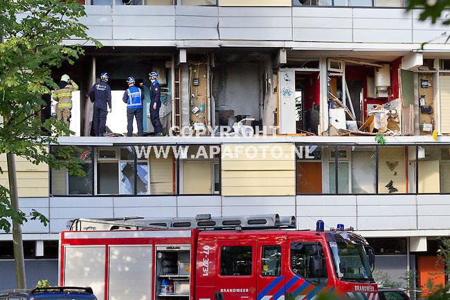 Arnhem, 130813<br /> Onderzoek in een van de vier compleet weggeslagen flatwoningen aan het Driemondsplein.<br /> Foto: Sjef Prins - APA Foto