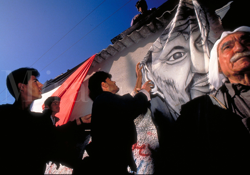 TITLE - DISTANT RELATIONS, PALESTINIAN FLAGS FLY AT A RALLY, BANNER OF ARAFAT IN BACKGROUND,. YASIR, ARAFAT.