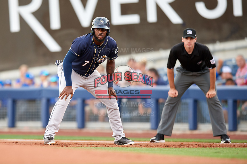 San Antonio Missions right fielder Franmil Reyes (7) leads off first base in front of first base umpire Nate Tomlinson during a game against the Tulsa Drillers on June 1, 2017 at ONEOK Field in Tulsa, Oklahoma.  Tulsa defeated San Antonio 5-4 in eleven innings.  (Mike Janes/Four Seam Images)