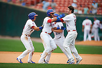 Buffalo Bisons outfielder Dalton Pompey (37) celebrates with Munenori Kawasaki (66), Ryan Schimpf (27) and Matt Hague (16) after a game winning hit during a game against the Columbus Clippers on July 19, 2015 at Coca-Cola Field in Buffalo, New York.  Buffalo defeated Columbus 4-3 in twelve innings.  (Mike Janes/Four Seam Images)